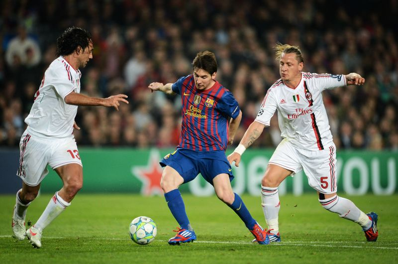 Alessandro Nesta (left) looks on as Lionel Messi goes past Phillipe Mexes