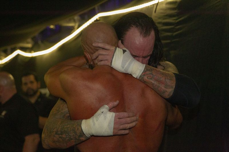 Undertaker and Triple H embrace backstage