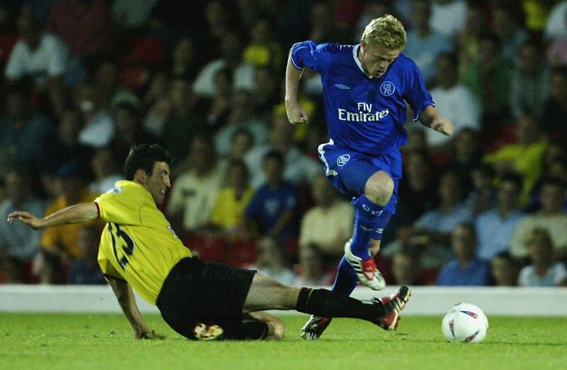 Damien Duff of Chelsea jumps a tackle
