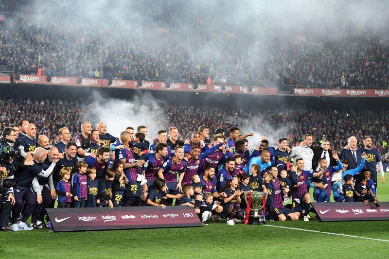 Barcelona players celebrate the 2019 La Liga trophy.