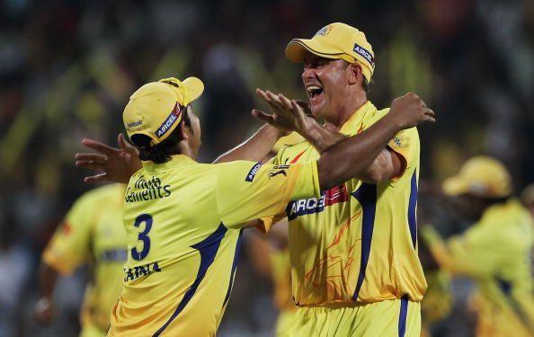 Suresh Raina and Matthew Hayden celebrate a wicket for CSK