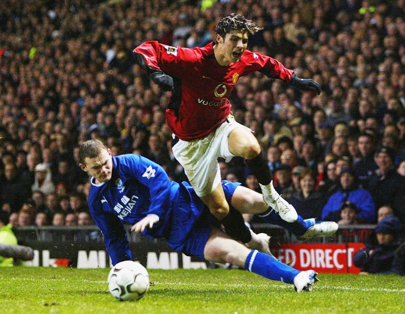 Cristiano Ronaldo skips past Wayne Rooney, who would later go on to become his teammate