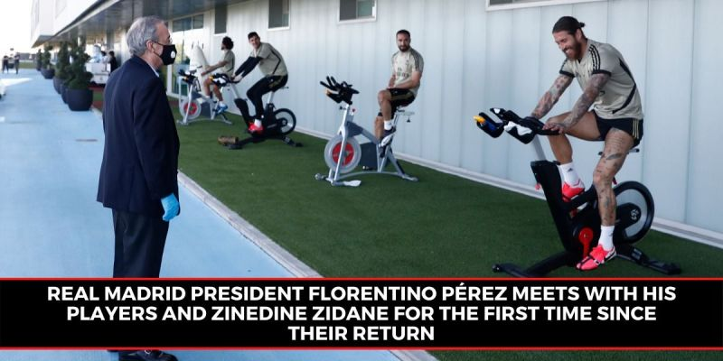 Real Madrid president Florentino Perez interacts with his players during the club
