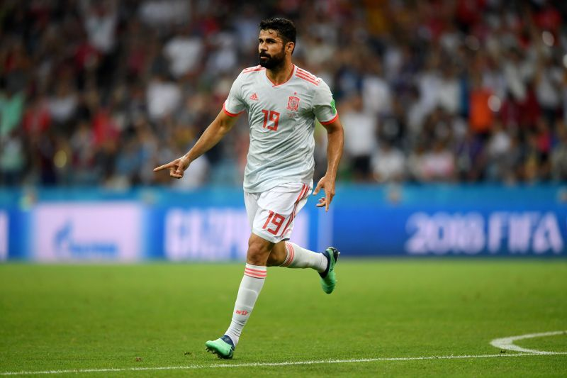 Diego Costa celebrates after scoring a goal against Portugal