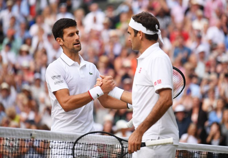 Novak Djokovic (L) and the man he is chasing, Roger Federer