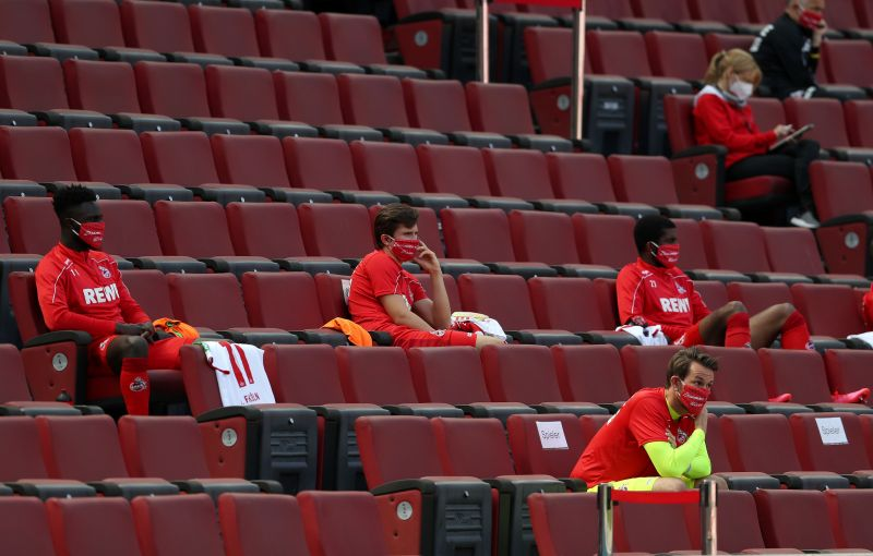 Players on the bench sitting separately as part of the social distancing protocols