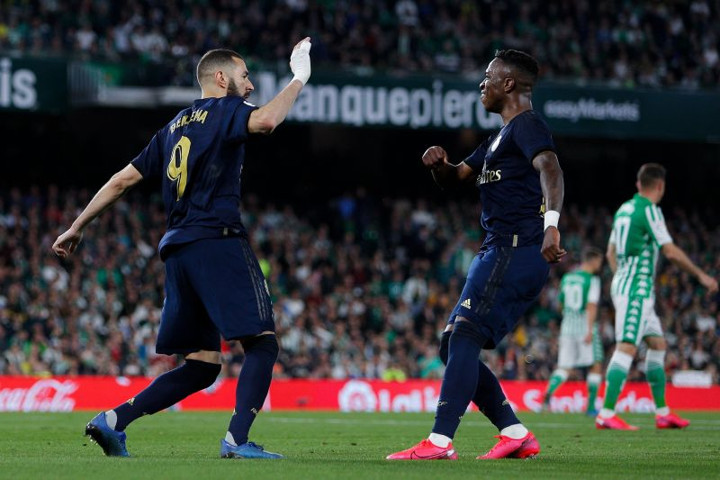 Benzema celebrates with Vinicius after scoring against Real Betis
