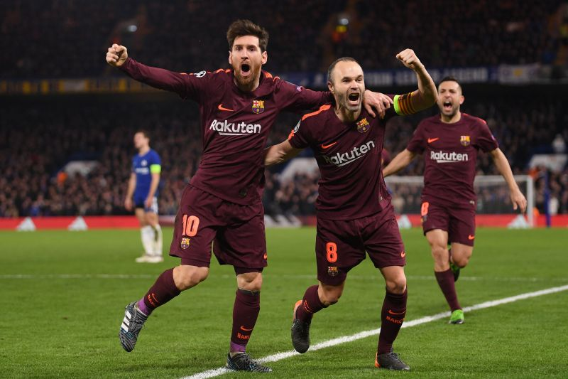 Messi and Andres Iniesta celebrate a goal against Chelsea.