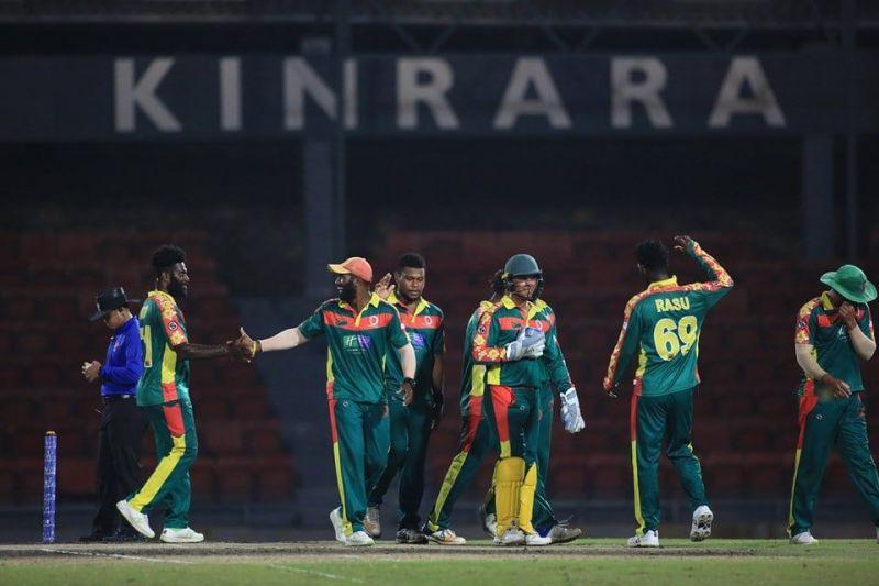Members of the Vanuatu national team celebrate a wicket