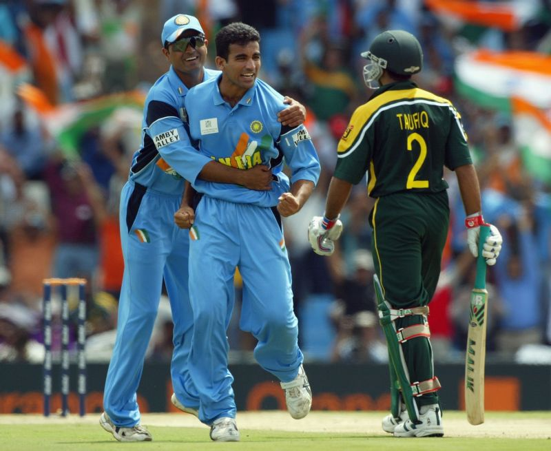 Dinesh Mongia (left) of India congratulates team-mate Zaheer Khan on the wicket of Taufeeq Umar of Pakistan