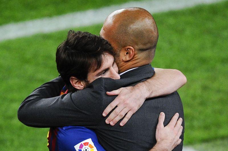 Lionel Messi hugs manager Pep Guardiola