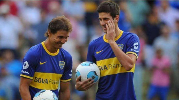 Rafael Nadal (L) in a football game with Novak Djokovic