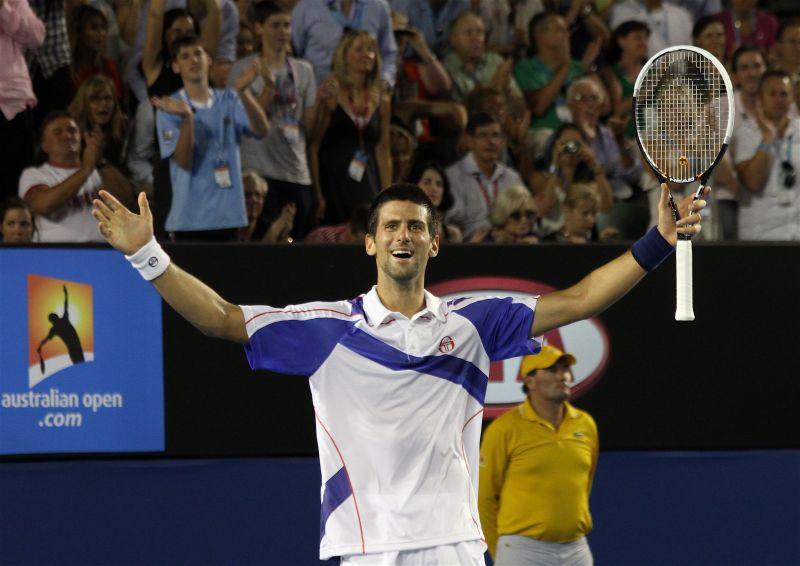 Novak Djokovic exults after winning the 2011 Madrid Masters title
