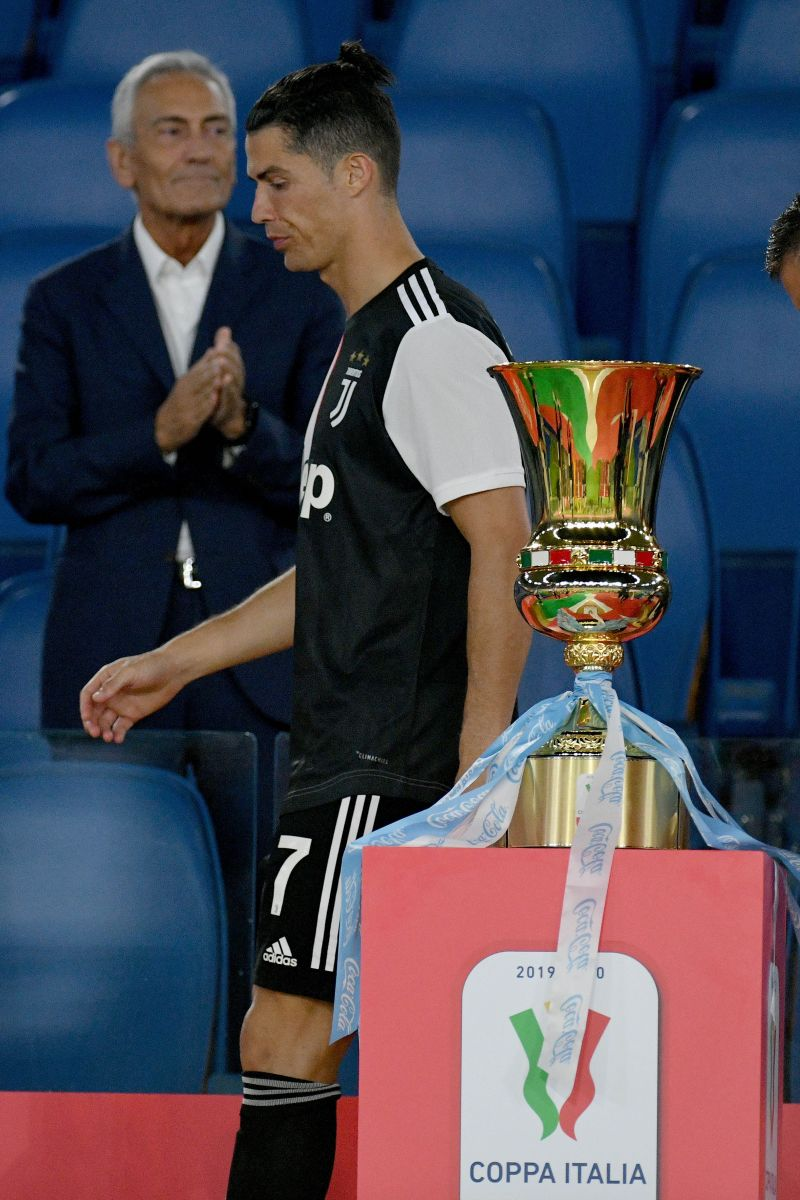A dejected Cristiano Ronaldo walks away from the Coppa Italia trophy. Juventus were beaten 4-2 on penalties by Gennaro Gattuso