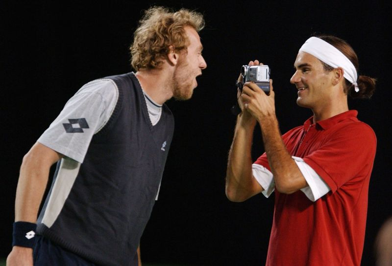 Marc Rosset (L) and Roger Federer (R)