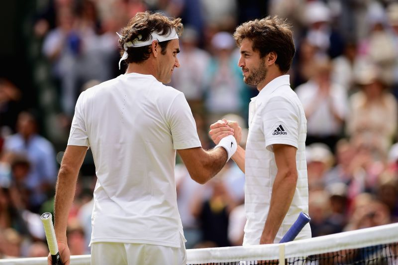 Roger Federer (L) and Gilles Simon