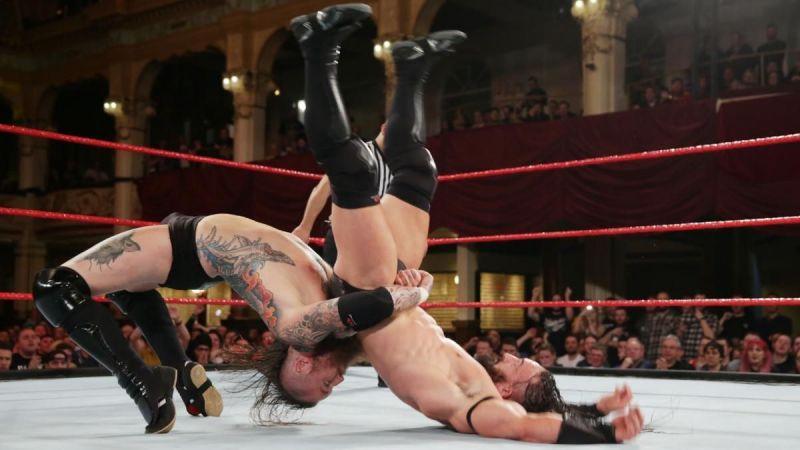 Aleister Black hitting Neville with a German Suplex.