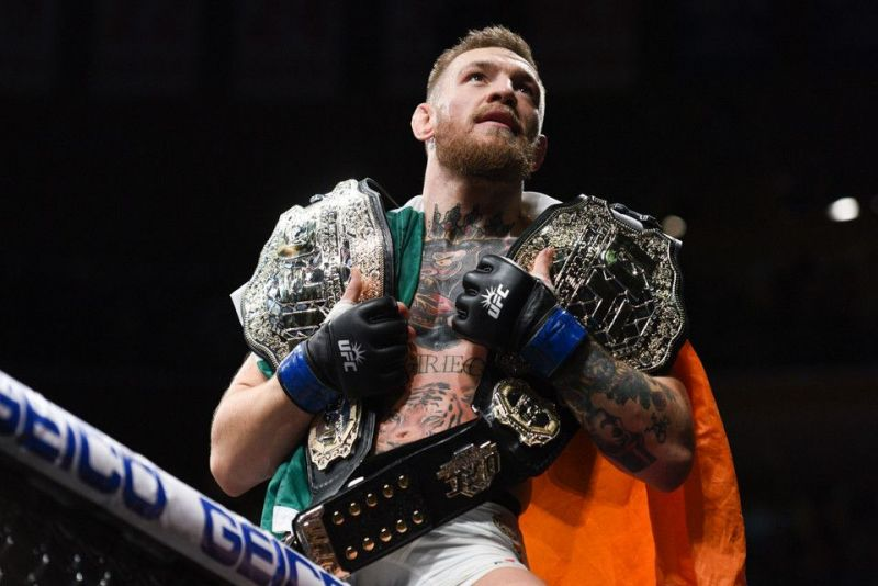 Conor McGregor with his two-division world titles
