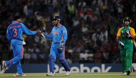 NAGPUR, INDIA - MARCH 12:  Harbhajan Singh of India celebrates with team mate MS Dhoni after the stumping of JP Duminy of South Africa during the Group B ICC World Cup Cricket match between India and South Africa at Vidarbha Cricket Association Ground on...