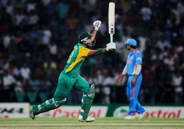 NAGPUR, INDIA - MARCH 12:  Robin Peterson of South Africa celebrates after scoring the winning runs during the Group B ICC World Cup Cricket match between India and South Africa at Vidarbha Cricket Association Ground on March 12, 2011 in Nagpur, India.