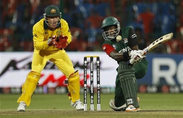 Kenya's cricketer Collins Obuya, right, attempts a shot as Australia's Brad Haddin, left, reacts during the Cricket World Cup Group A match between Australia and Kenya in Bangalore, India, Sunday, March 13, 2011.