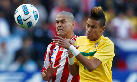 Brazil's Neymar challenges for possession