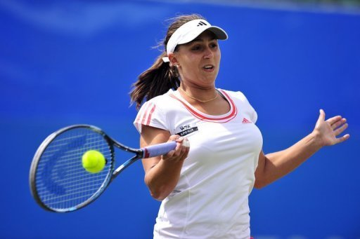 Austria's Tamira Paszek hits a shot during her semi-final match at the AEGON International in Eastbourne
