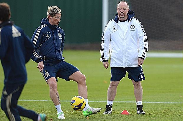 Do you remember me? Rafael Benitez watches Fernando Torres and the rest of the squad train ahead of their crunch meeting with Manchester City