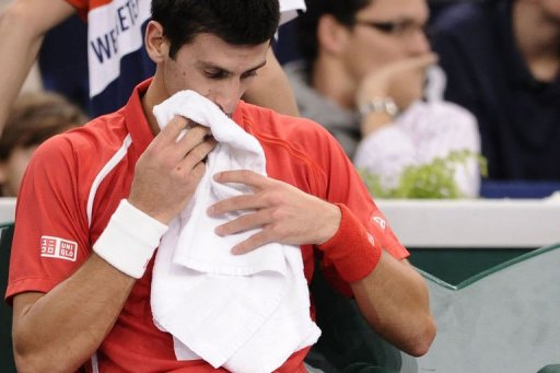 Novak Djokovic reacts after being defeated by Sam Querrey