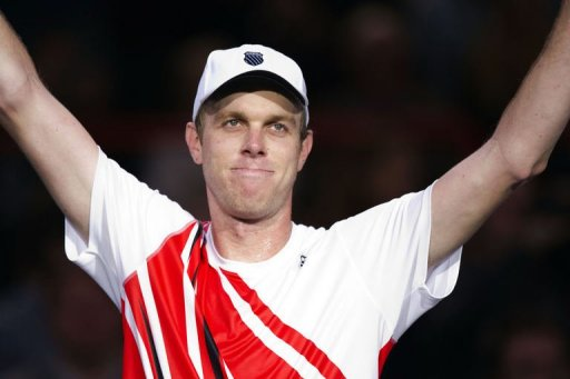 Sam Querrey celebrates after defeating Novak Djokovic