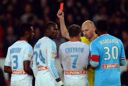 Marseille's Rod Fanni (2nd L) is given a red card by referee Antony Gautier