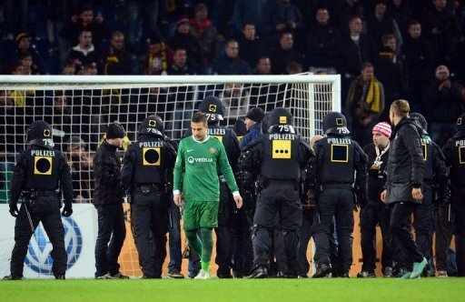 Police secure the inside of stadium in Hanover as fans of Dresden try to storm the pitch on October 31