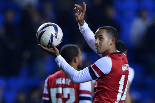 Theo Walcott salutes the crowd on October 30