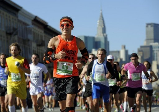 Runners make their way through Queens during the 2011 New York City Marathon
