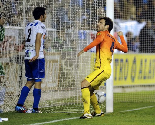 Barcelona's midfielder Cesc Fabregas celebrates after scoring
