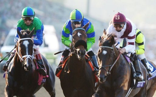 Jockey Mike Smith riding Royal Delta (R) won his16th Breeders' Cup