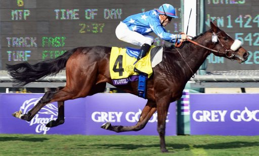 Jockey Christophe Lemaire rides Flotilla to victory in the Breeder's Cup Juvenile Fillies Turf race