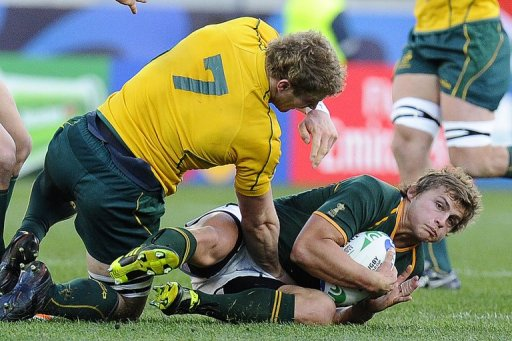 Springboks' upcoming star Patrick Lambie (R), seen here during a match against Australia, in 2011