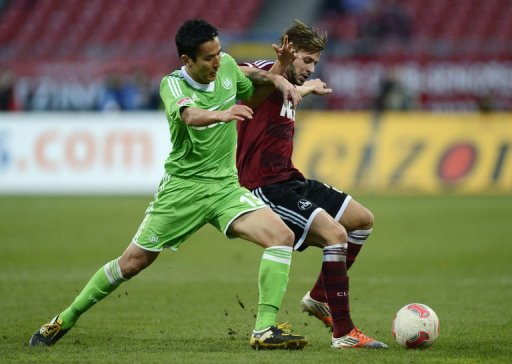 Wolfsburg' midfielder Hakoto Hasebe (L) and Nuremberg's defender Marvin Plattenhardt fight for the ball