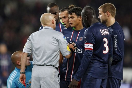 French referee Laurent Duhamel (2ndL) gives a red card to Paris Saint-Germain's forward Zlatan Ibrahimovic (C)