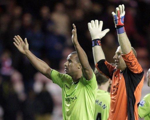 Aston Villa's goalkeeper Brad Guzan (R) and striker Gabriel Agbonlahor celebrate