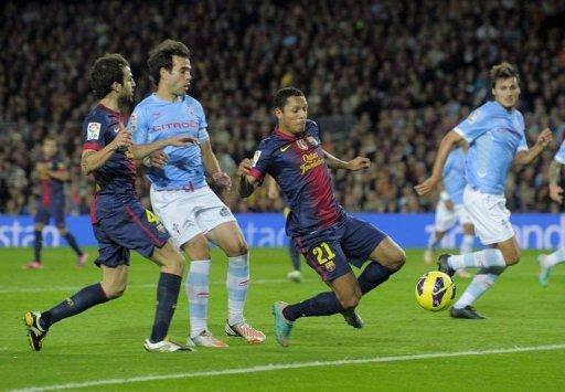 Barcelona's defender Adriano Correia (C) scores