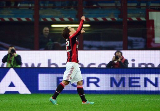 AC Milan's forward Bojan Krkic (C) celebrates after scoring