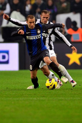 Inter Milan's forward Rodrigo Palacio (L) fights for the ball with Juventus defender Giorgio Chiellini