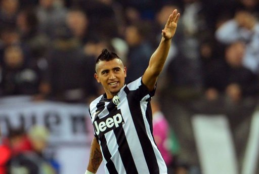 Juventus' midfielder Arturo Vidal celebrates after scoring