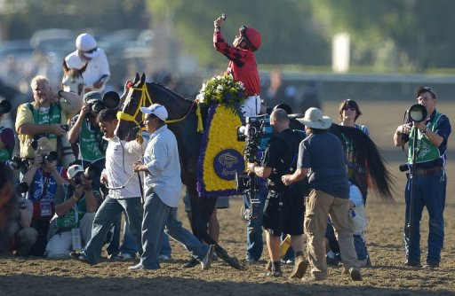 Jockeys Willie Martinez on Trinniberg celebrates after the Breeders' Cup Sprint