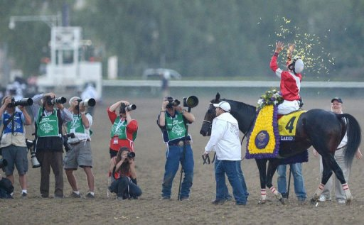 Jockey Brian Hernandez on Fort Larned celebrates his victory at the Breeders' Cup Classic