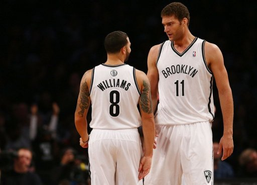 Brook Lopez scored 27 points helping the Brooklyn Nets to a 107-100 victory over Toronto