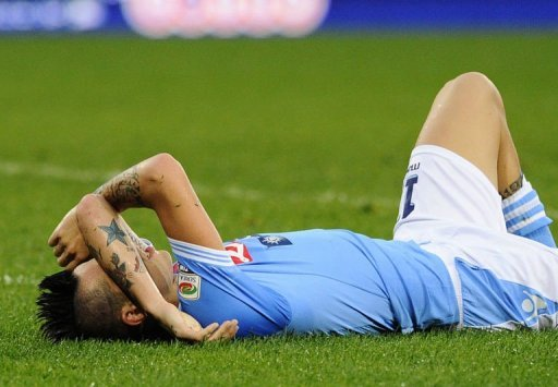 Napoli's Marek Hamsik lies on the pitch after the match