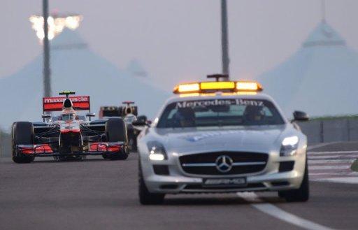 Lewis Hamilton follows the safety car at the Yas Marina circuit